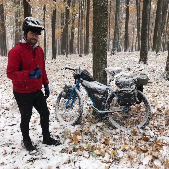 Justin Tadych biking in the snow